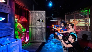 Family enjoying a game at NERF Action Xperience in Marina Square.