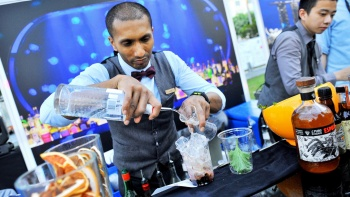 Bartender concocting a drink at Singapore Cocktail Festival