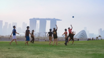 Group of boys playing soccer at Marina Barrage