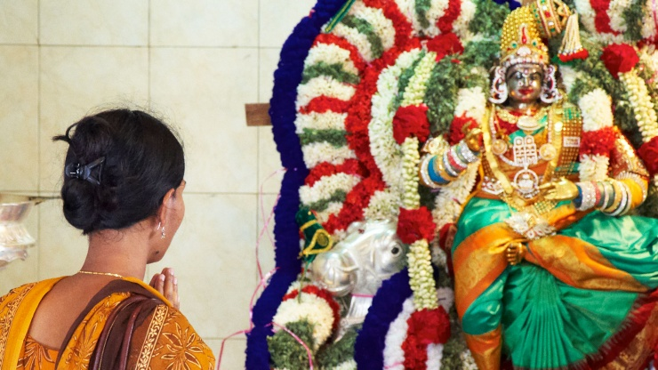 A lady praying at the Sri Veeramakaliamman Temple