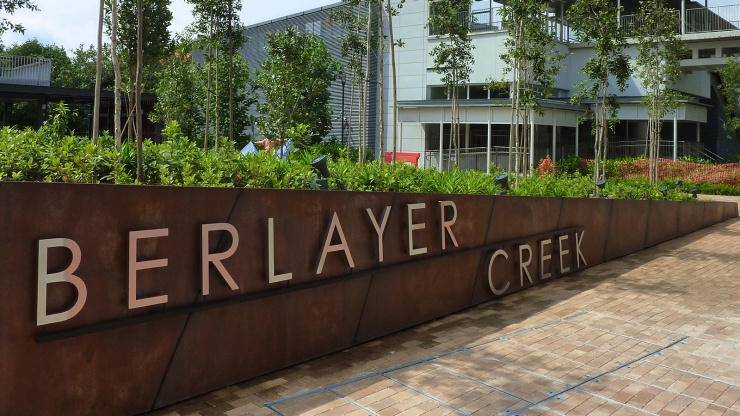 Exterior shot of the entrance signage reading Berlayer Creek