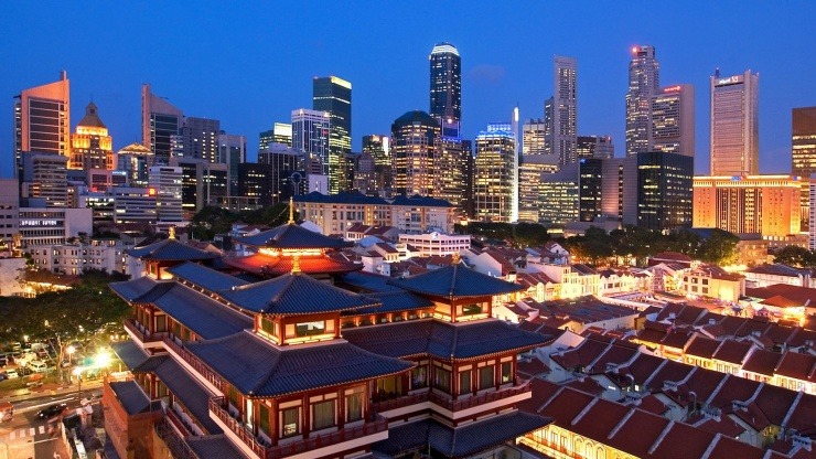 Aerial night view of Chinatown with Buddha Tooth Relic Temple against the CBD skyline