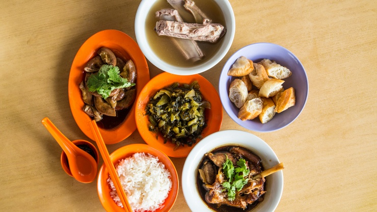 Savor the flavors of Singapore. Don't miss Bak Kut Teh, a fragrant pork rib dish with garlicky and peppery broth, typically served with preserved salted vegetables and crispy dough fritters