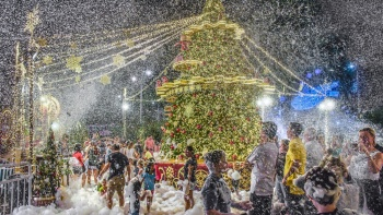 People enjoying the fake snow bubbles released outside Tanglin Mall.