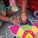 Colourful flower design Rangoli created on the floor