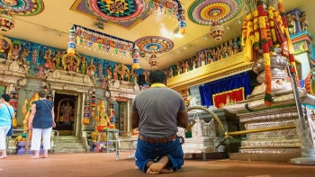 Man praying in a temple