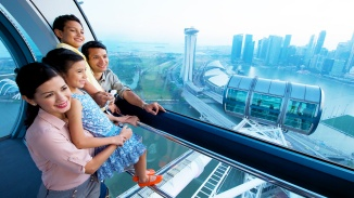 Family watching the National Day parade in Singapore Flyer