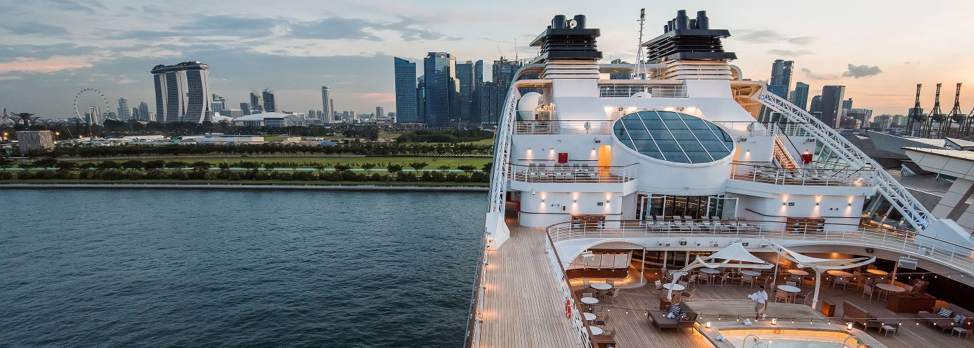 Top deck of a cruise ship, with Marina Bay Sands® in the background