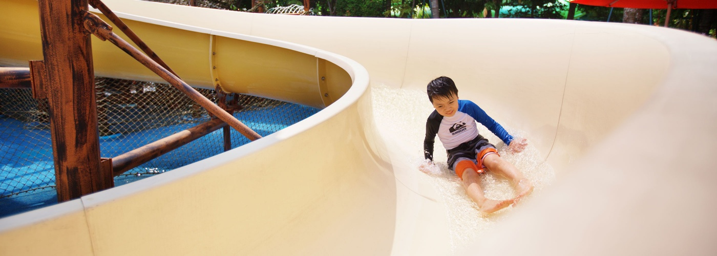 Boy on water slide ride at The Adventure Cove Waterpark