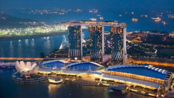 A beautiful capture of a bird's eye view of Marina Bay Sands and The ArtScience Museum in the evening