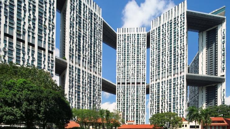 Beautiful façade view of Pinnacle@Duxton with lush greenery in the foreground