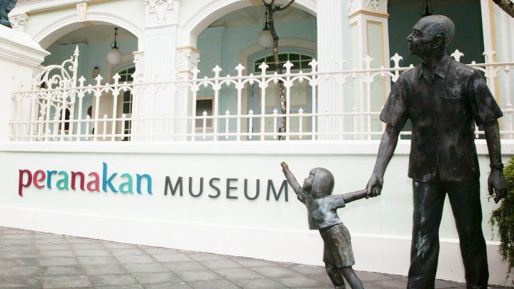 Statues at the entrance of Peranakan Museum