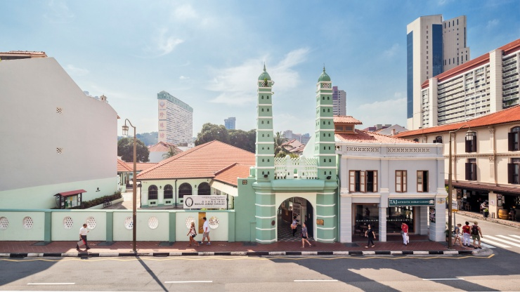The iconic pastel green exterior of Jamae Mosque