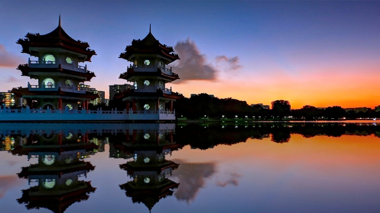 Reflections of twin pagodas at the Chinese Garden at dusk