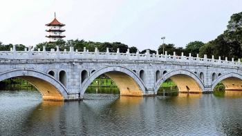 The 13-arch bridge on tranquil waters.