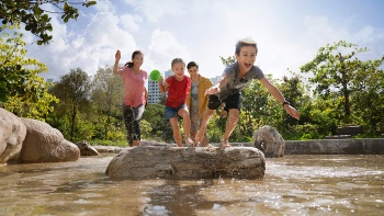 A family having fun at the Forest Ramble nature-themed play space in Jurong Lake Gardens