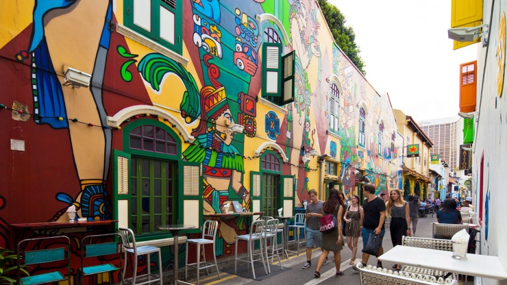 Passers-by admiring the wall murals along Haji Lane