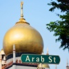 Close up of Arab Street road sign against the backdrop of Sultan Mosque dome