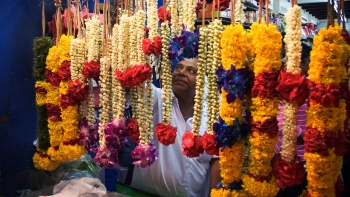 Traditional glower garlands draped outside a shopfront for sale