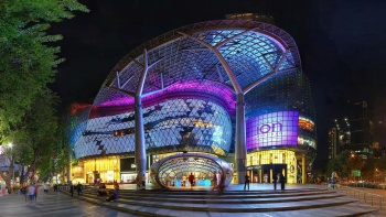 Façade of ION Orchard at night.