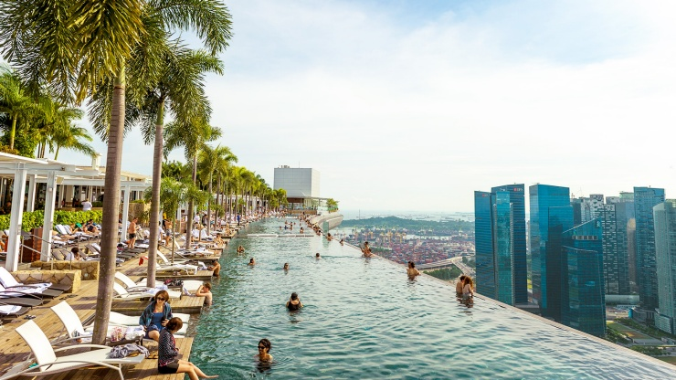 The Infinity pool at Marina Bay Sands<sup>®</sup> SkyPark overlooking the Singapore skyline