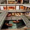 Interior of The Shoppes at Marina Bay Sands with a view of the Sampan Rides along the indoor Canal