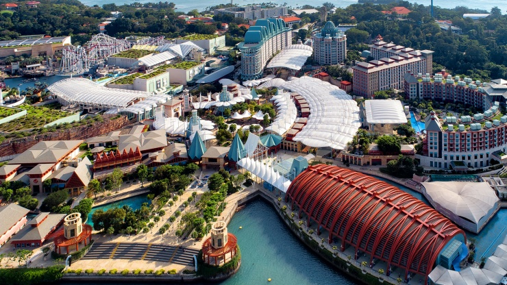 A view of Resorts World™ Sentosa across the sea