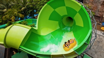 Visitors on a waterpark ride at Adventure Cove Waterpark™