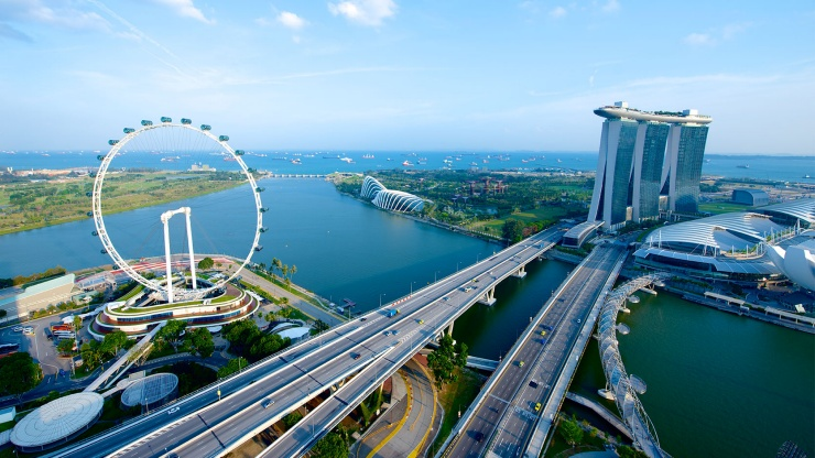 Aerial view of the iconic Singapore skyline with the Singapore Flyer, Marina Bay Sands® and Gardens by the Bay.