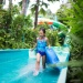 Girl having fun on a water slide at Adventure Cove, Sentosa