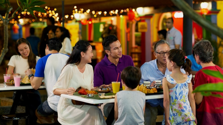 Family with active silvers dining at an eatery near Tan Teng Niah, Little India.