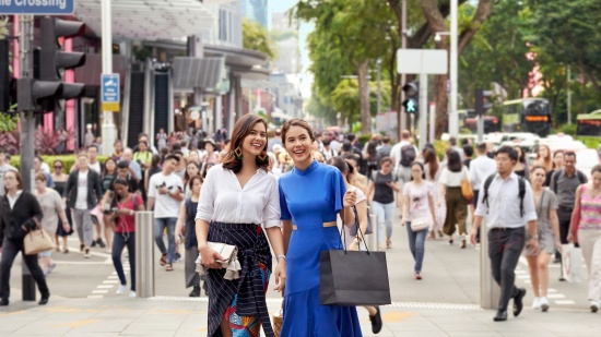 Ladies decked out in local brands shopping along Orchard Road