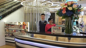 Two customer service officers at the ION Orchard concierge