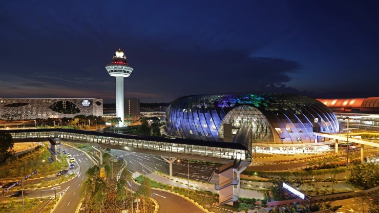 Wide shot of Jewel Changi and the control tower at night