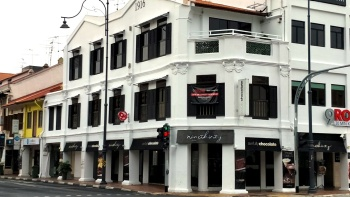 4 friends having a meal at Guan Hoe Soon, Singapore's oldest Peranakan restaurant
