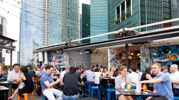 Daytime outdoor scene of people drinking at kinki Restaurant + Bar Collyer Quay